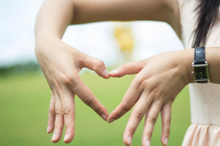 Hands with heart symbol photo