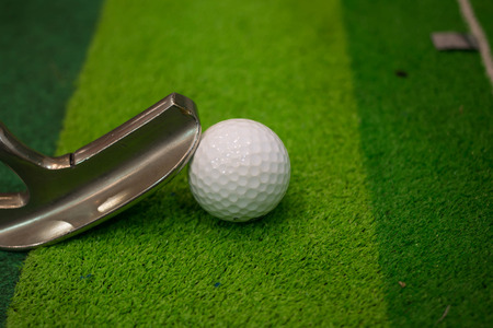 Golf ball on a golf course green photo