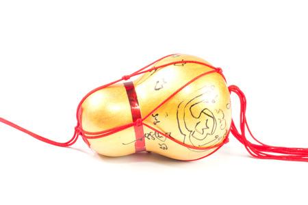 teorema: Amuleto hecho de una calabaza en el fondo blanco Foto de archivo