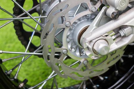 supercross: Enduro motorbike wheel and chain. Closeup shot
