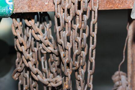 rusty chain: Rusty steel chain through use