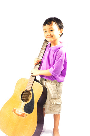 hardrock: Asian boy with guitar isolate on white Stock Photo