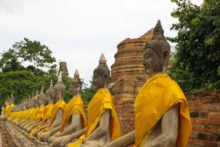 chaimongkol: Row of old Buddha Status at Wat Yai Chaimongkol, Ayutthaya, Thailand