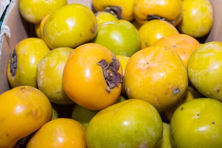 persimmons: Persimmons fruit at the farmers market Stock Photo