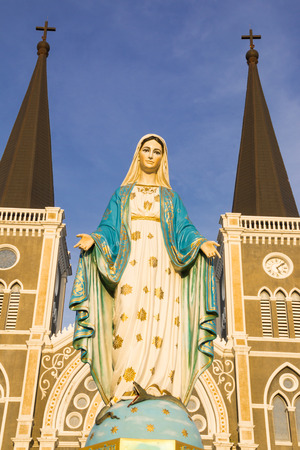 mary mother of jesus: Virgin Mary Statue blue sky background in Thailand church Stock Photo
