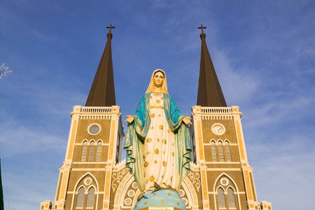 virgin mary mother of god: Virgin Mary Statue blue sky background in Thailand church Stock Photo