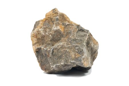 obrero: Roca basáltica aislante en blanco Foto de archivo