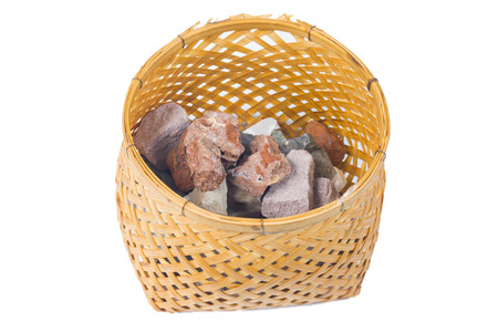 the Mineral  marlstone in bamboo basket handmade isolated on white background