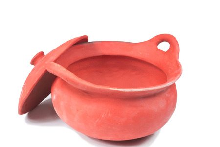 red clay: Traditional stoves and pots set made of red clay Stock Photo