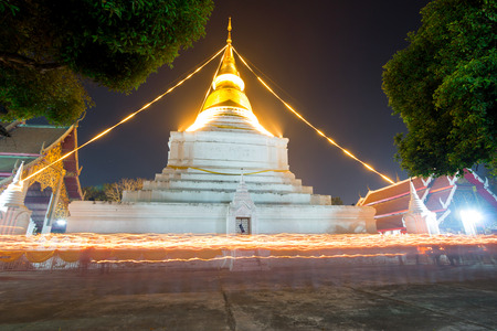 buddhists: Makha Bucha Day, Candle lit from buddhists are moving around pagoda at Wat Phra Kaew Don Tao of lampang,Thailand Stock Photo