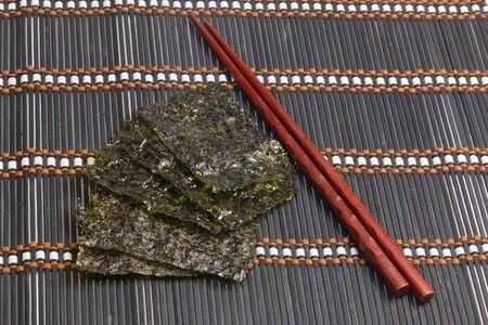 nori: Roasted seaweed snack (kim nori) on bamboo mat