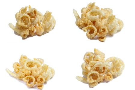 rinds: Fried pork rinds over a white background