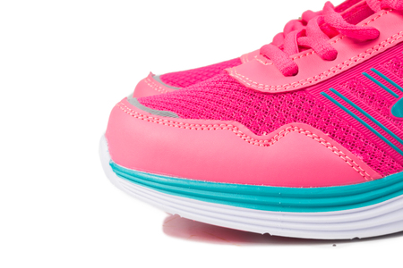 Pink sport shoes on white background Stock Photo