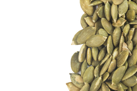 Dried pumpkin seeds isolate on white Stock Photo