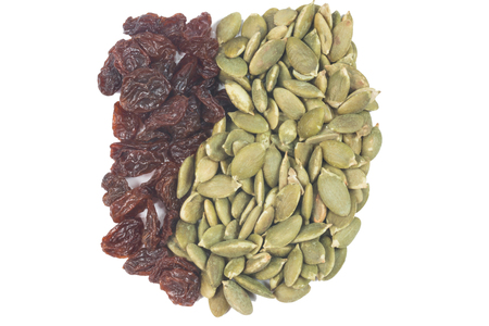 sultana: Dried raisins and Dried pumpkin seeds isolate on white Stock Photo