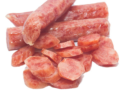 longaniza: pork meat sausages isolated on a white background