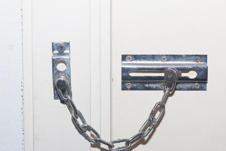 Locked Doors. The Locking Mechanism On The Old Door. Close-up ...