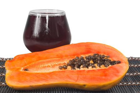 Papaya with Glass of juice isolate on white