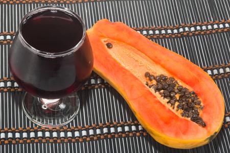 free radicals: Papaya with Glass of juice isolate on white