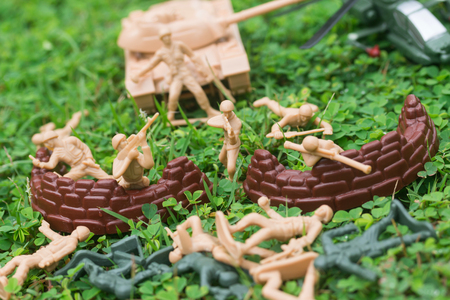 plastic soldier: Plastic toy soldiers are doing war Stock Photo