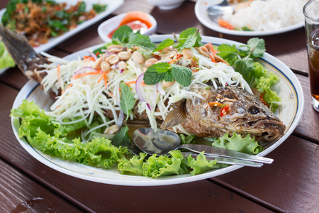 striped snakehead fish salad in restaurant Stock Photo