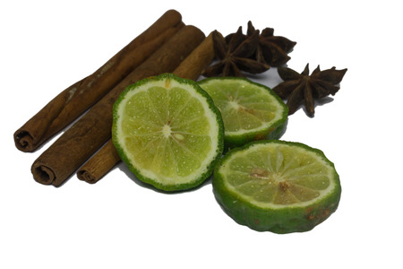 Bergamot or Kaffir lime Cut half with cinnamon and star aniseed isolate on white background Stock Photo