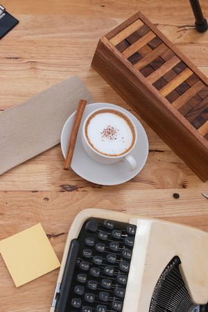 hot coffee in cup and coffee bean On the wooden table