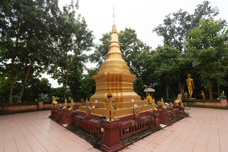 Golden Pagoda of temple is in the forest