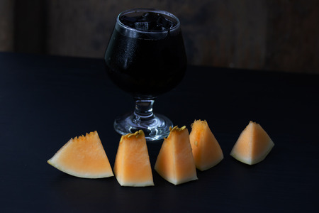 Fresh Melon with Grass jelly In a glass isolated on table background