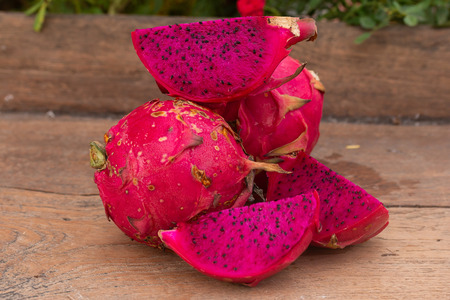 purple dragon fruit on table wood on nature background Foto de archivo