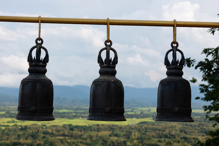 three Bell Made of brass in Thailand temple in Mountainous background