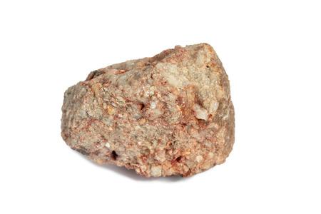 Isoler la pierre de conglomérat sur fond blanc