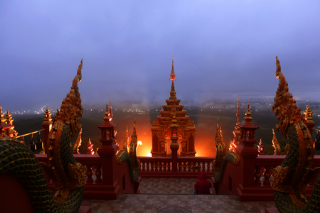Beautiful Naga statue and arched entrance In the morning Before sunrisenat Wat Doi Phra Chan in Thailand temple