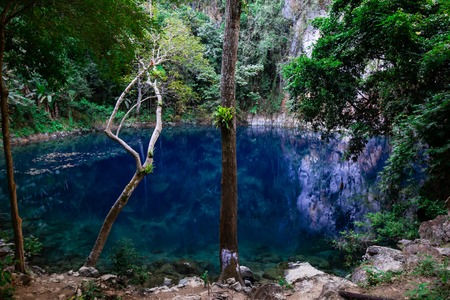 natural fountain or subterranean course of water on crater Beautiful like emerald green in lampang Thailand Stock Photo