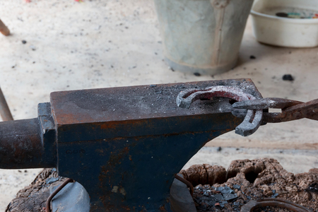 Farrier making horseshoe by Ancient style