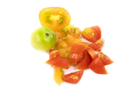 Brightly colored tomatoes isolated over white background
