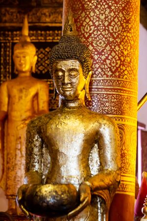 Beautiful golden Buddha Statue In the temple of Thailand