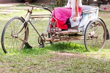 Ancient tricycle In the old house of Thailand