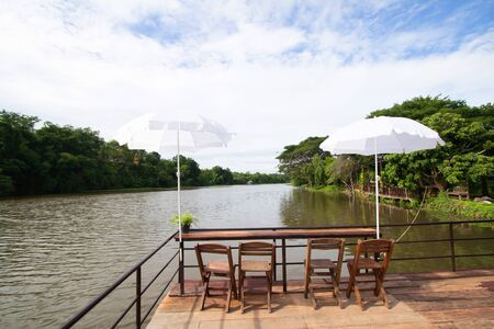 Tables and chairs for living On the raft In the river Banco de Imagens