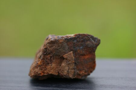 Iron Rock minerals for industry isolate on green background