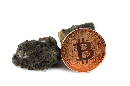 Basalt rock and bit coin isolate on white background