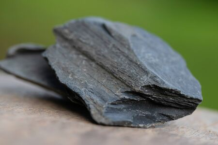 minerals of Slate Rock for industry  isolate on green background Stock Photo