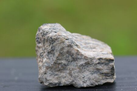 minerals of granite stone for industry isolate on green background