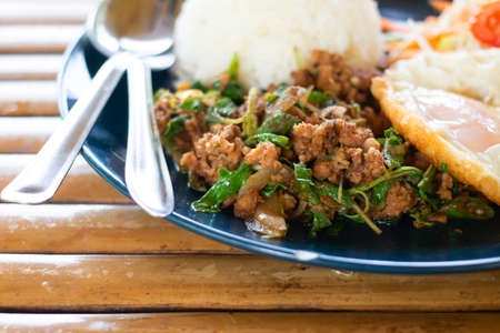Rice topped with stir-fried pork and basil