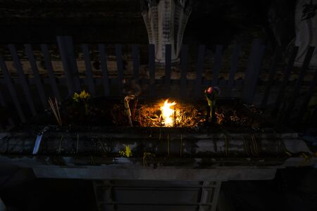 Candle lit tradition in temple of Thailand