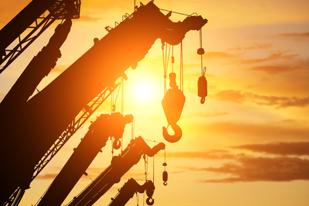 silhouette crane truck in flare light for logistic background