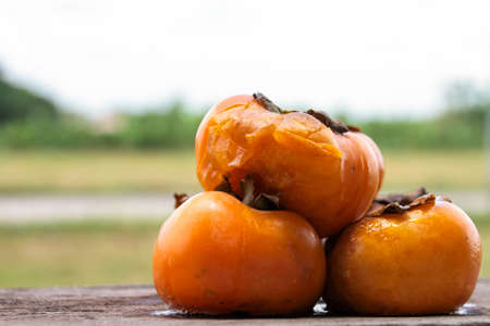 Persimmons rotten on the wood Stock fotó - 153224969