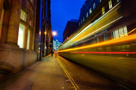 A tail lights of a tram passing through Manchester city centre photo