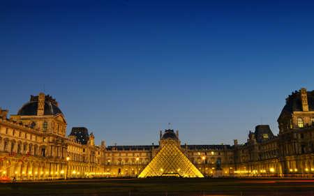 The panoramic view of Louver museum Paris at night