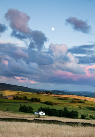 A beautiful landscape with a full moon and green pastures photo